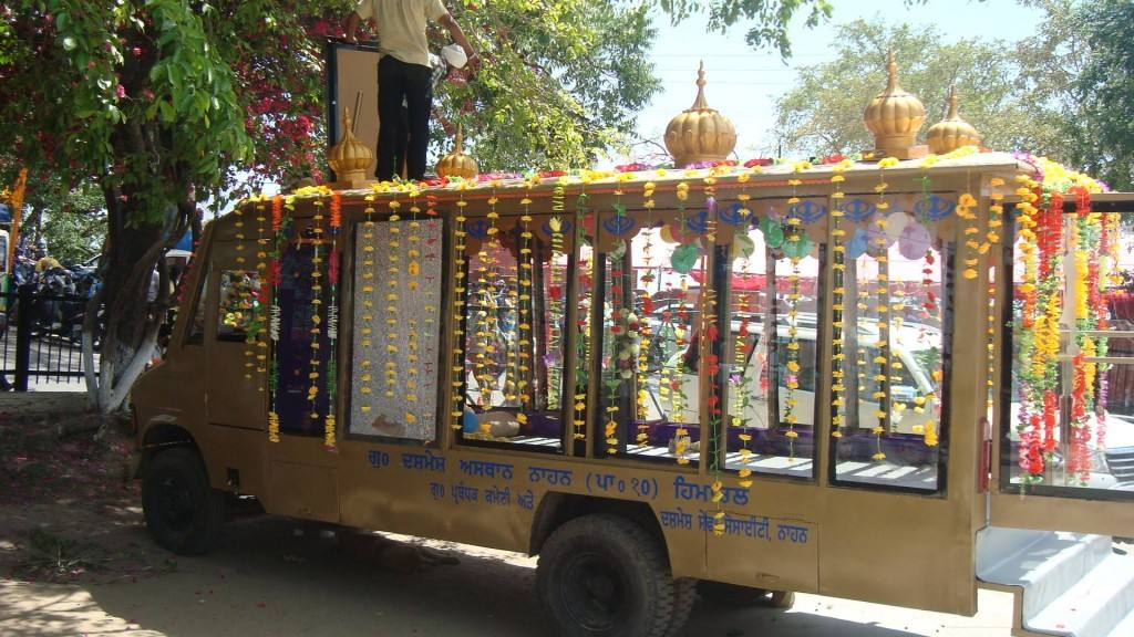 Palki Sahib on Wheels with Golden Domes