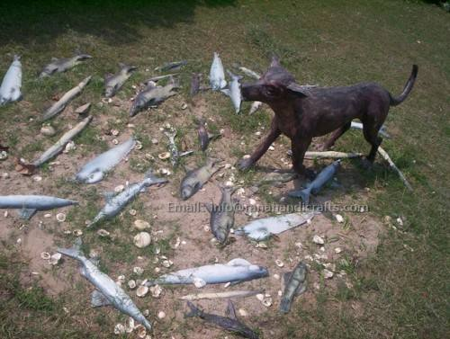 Dog eating Fish Sculpture