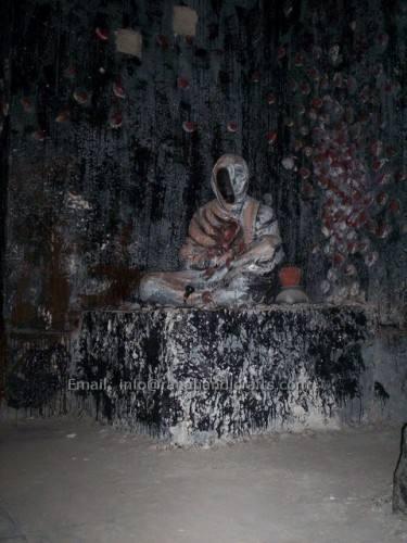 dead man sitting sculpture