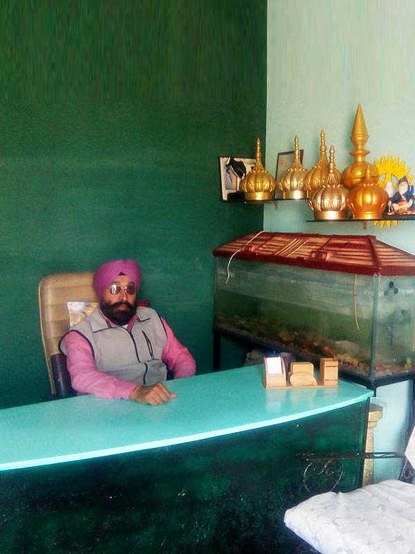 Sarbjit Singh MD with Sample Gurdwara Domes